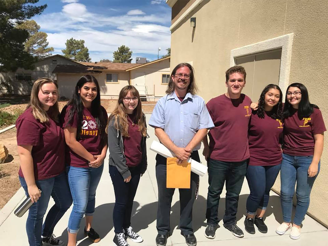 Special to the Pahrump Valley Times PVHS band instructor Michael Wineski, center stand with members of the school's marching band after the town governing board approved funding $30,000 for a trip ...
