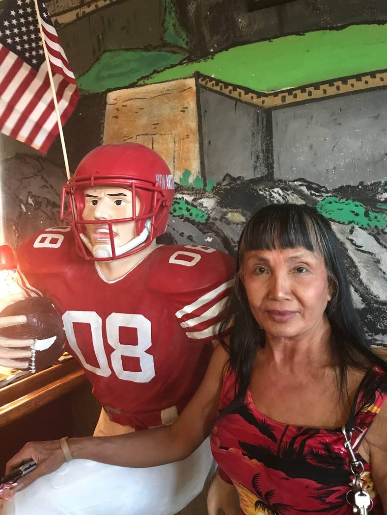 Jeffrey Meehan/Pahrump Valley Times Leilani Ancoine, owner of Sullivan's Pub in Pahrump, stands next to a football statue at 2450 W. Mesquite Ave. on Aug. 23, 2018. Ancoine said she took over the ...