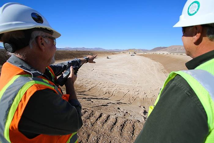Special to the Pahrump Valley Times/U.S. Department of Energy Supervisors oversee the excavation and grading of a mixed low-level radioactive waste site in Area 5 of the Nevada National Security S ...