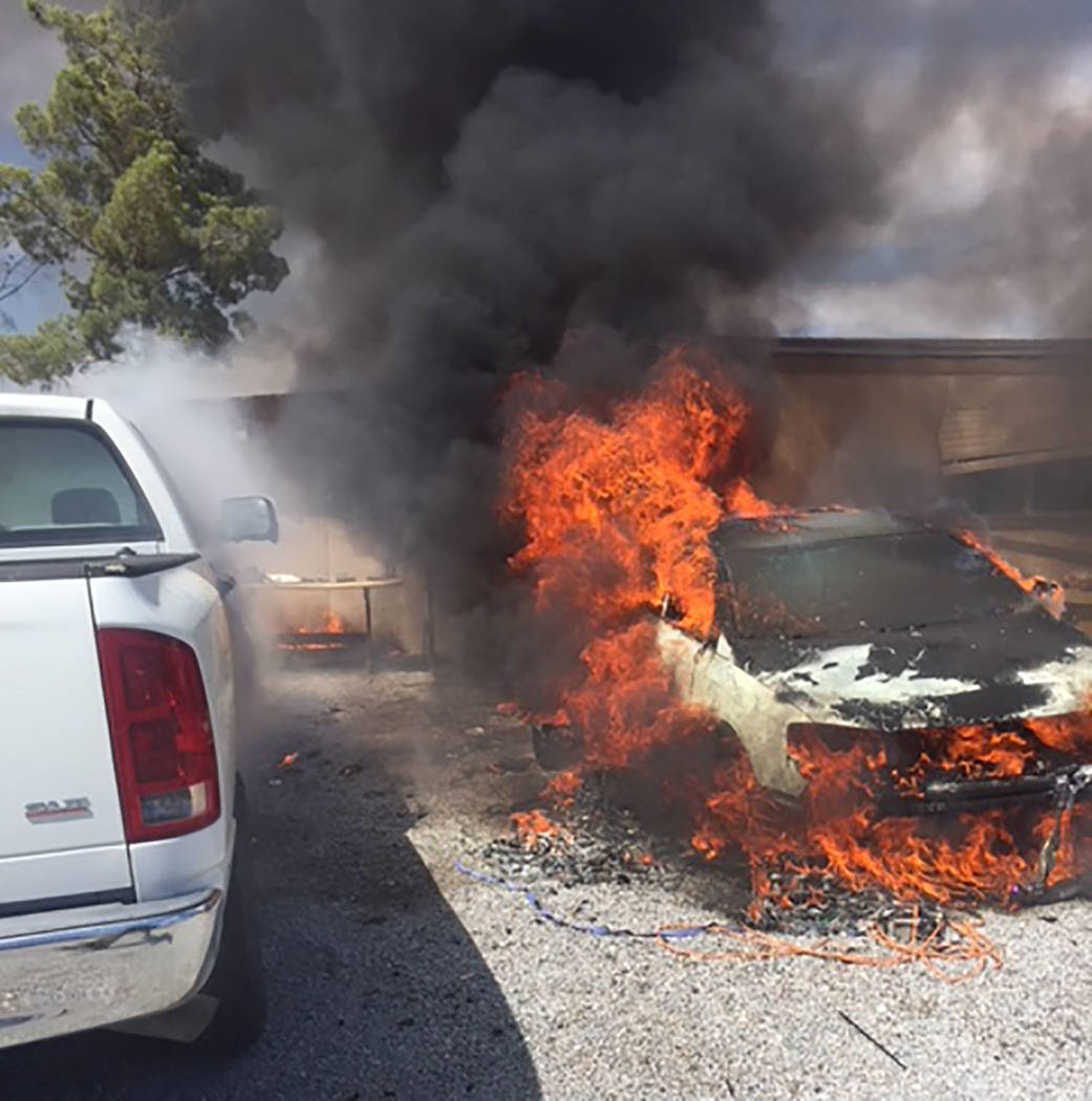 Special to the Pahrump Valley Times A box of over-pressurized aerosol cans inside a car is suspected to be the cause of an early afternoon vehicle fire, which extended to a residence along West Vo ...