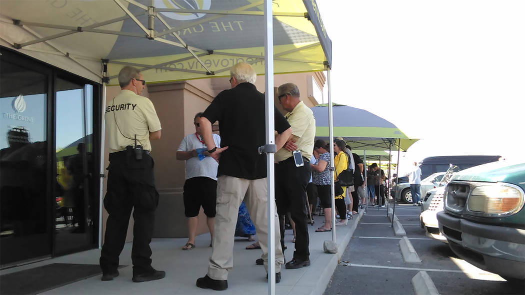Selwyn Harris/Pahrump Valley Times Scores of local residents await their turn to legally purchase marijuana when Pahrump's Grove dispensary opened their doors on July 1, 2017. Grove Manager Zachar ...
