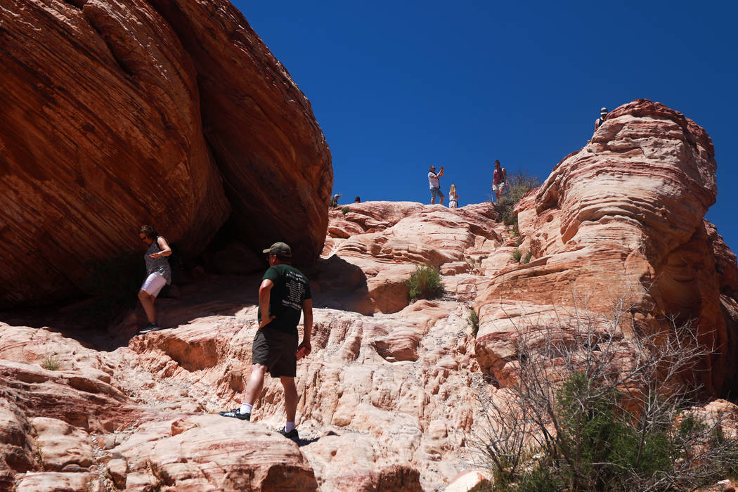 Andrea Cornejo/Las Vegas Review-Journal Visitors walk around Red Rock Canyon National Conservation Area in Las Vegas on Monday, May 7, 2018.