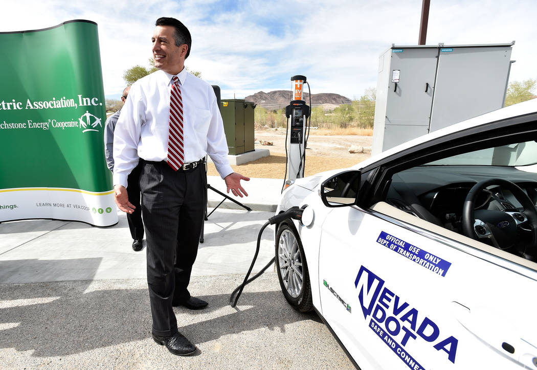 David Becker/Las Vegas Review-Journal Nevada Gov. Brian Sandoval stands at an electric car charging station in Beatty in March 2016. The Governor's Office of Energy has announced a station will s ...