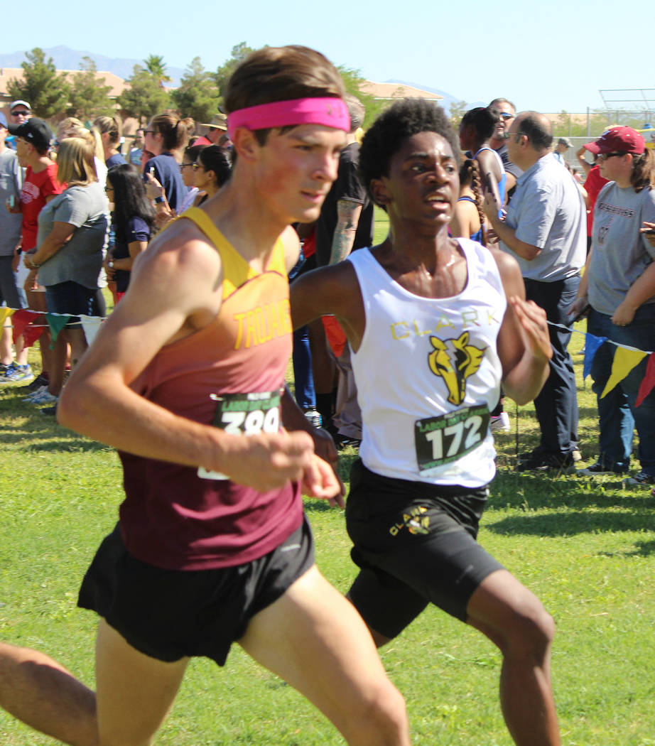 Tom Rysinski/Pahrump Valley Times Jacob Cipollini, left, of Pahrump Valley goes toe to toe with Clark's Michael Finley near the finish line of the Labor Day Classic at Palo Verde High School. The ...