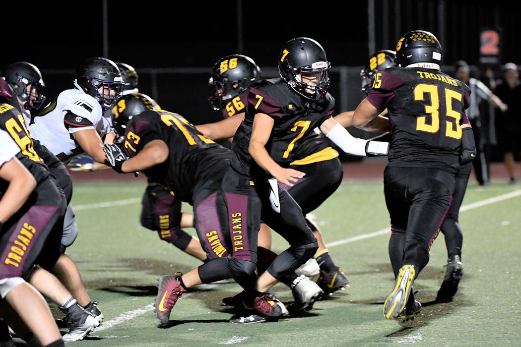 Peter Davis/Special to the Pahrump Valley Times Quarterback Dylan Wright hands off to Nico Velazquez during Pahrump Valley's homecoming victory over Sunrise Mountain on Friday night.