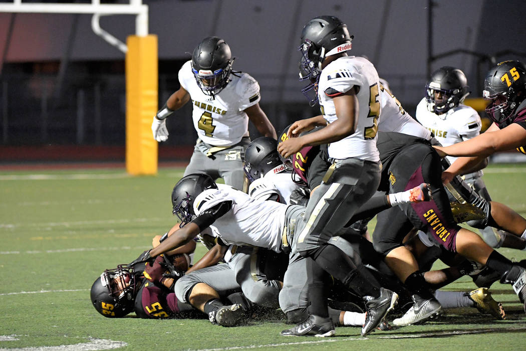 Peter Davis/Special to the Pahrump Valley Times It takes a village to bring down Pahrump Valley senior Nico Velazquez, who has rushed for more than 500 yards in three games this season.