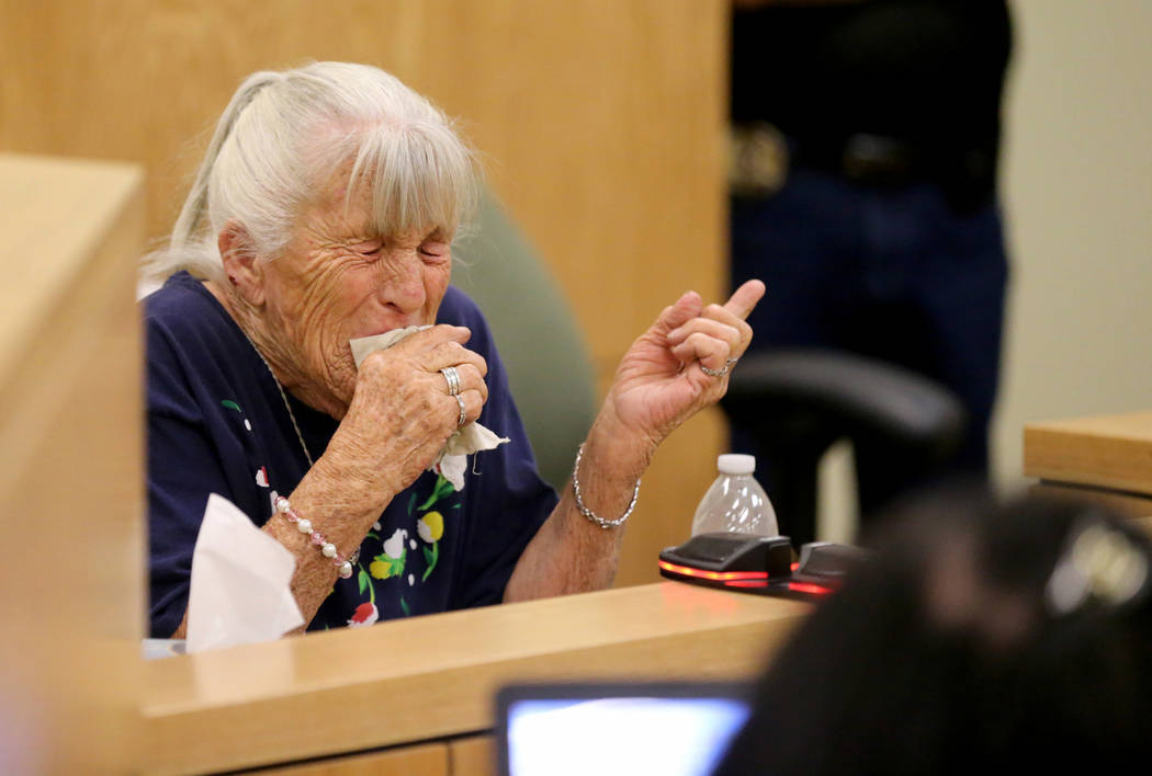 Donna Liebig, mother of Dawn Liebig, points to her grandsons Michael Wilson and Dakota Saldivar, during their preliminary trial in Pahrump Justice Court Thursday, Aug. 30, 2018. The teen brothers ...