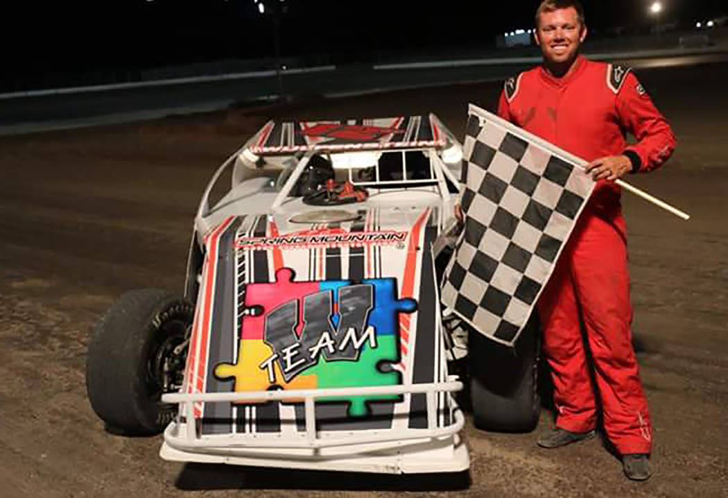 Rob Street Racing Photography/Special to the Pahrump Valley Times Byran Wulfenstein celebrates his victory in the Modifieds race Saturday night at Pahrump Valley Speedway.