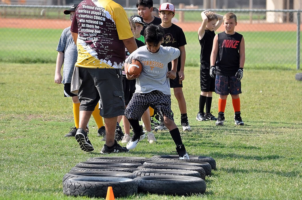 Horace Langford Jr./Pahrump Valley Times Pahrump youth football players go through drills during a July combine at Petrack Park. Three Pahrump teams will play their second game of the season Satur ...