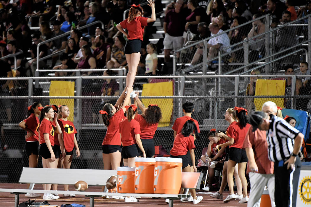 Peter Davis/Special to the Pahrump Valley Times The Pahrump Valley cheer team worked to keep the homecoming crowd in the game as the Trojans rolled to an easy 42-14 win.