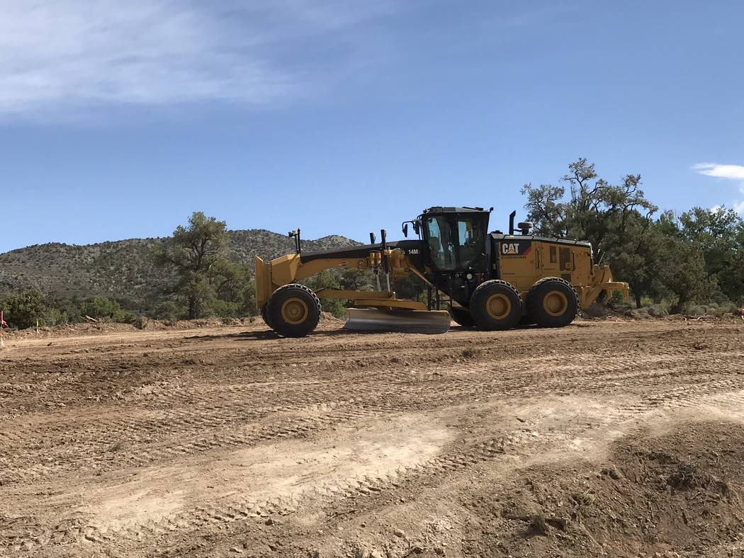 Jeffrey Meehan/Pahrump Valley Times Crews work along Highway 160 in the Mountain Springs area on Sept. 5, 2018. The road is being widened from two to four lanes, among other work.