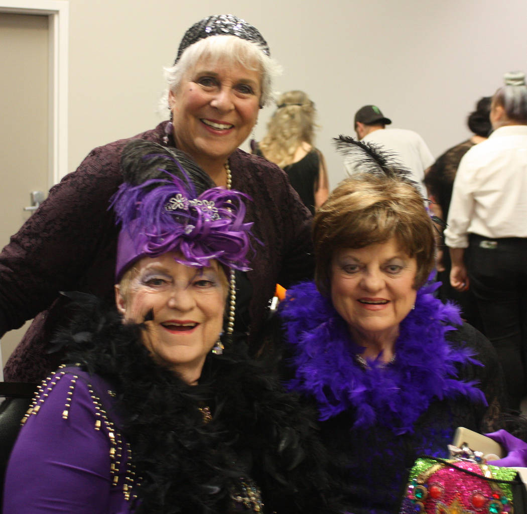 Robin Hebrock/Pahrump Valley Times Pioneer Territory CASA Executive Director Willi Baer poses with the CASA volunteers during the organization's Roaring 20s Quarter Auction fundraiser.