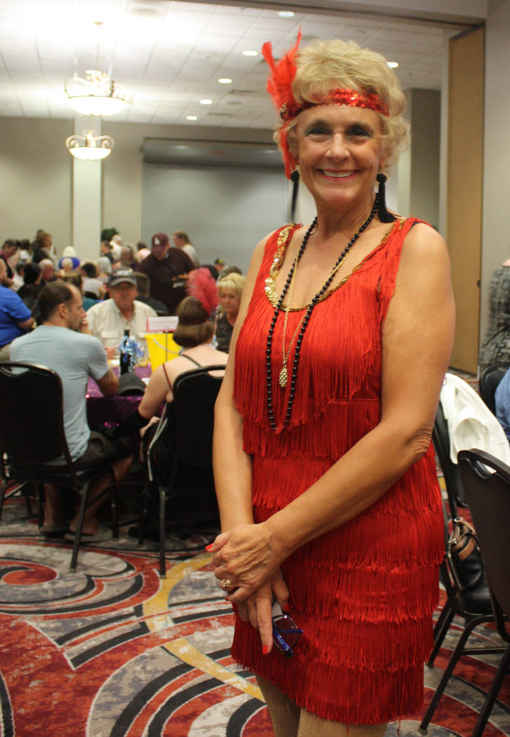 Robin Hebrock/Pahrump Valley Times Ms. Senior Golden Years USA and Nevada Silver Tappers member Michelle Caird sports a flashy, red flapper dress and matching headband at the Roaring 20s fundraiser.