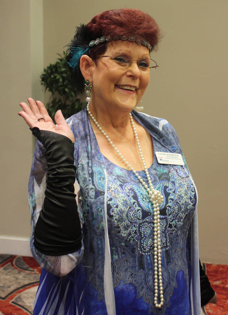 Robin Hebrock/Pahrump Valley Times CASA board member Laura Haywood strikes a playful pose in her Roaring 20s garb.