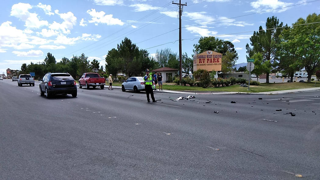 Selwyn Harris/Pahrump Valley Times A Nye County Sheriff's Office auxiliary officer directs traffic as law enforcement crews investigate a two vehicle crash at Highway 160 and Dandelion Street. One ...