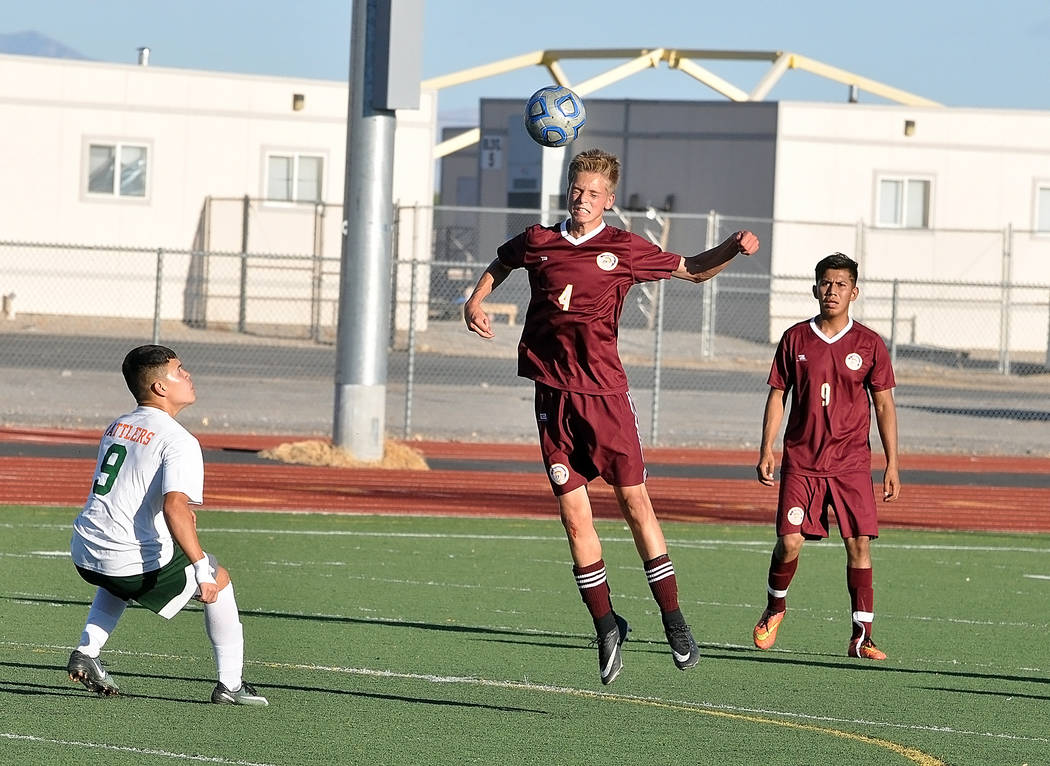 Horace Langford Jr./Pahrump Valley Times Sophomore Vincent DiBlasi goes up for a header Thursday during Pahrump Valley's 2-1 win over Mojave that opened Class 3A Sunset League play for the Trojans.