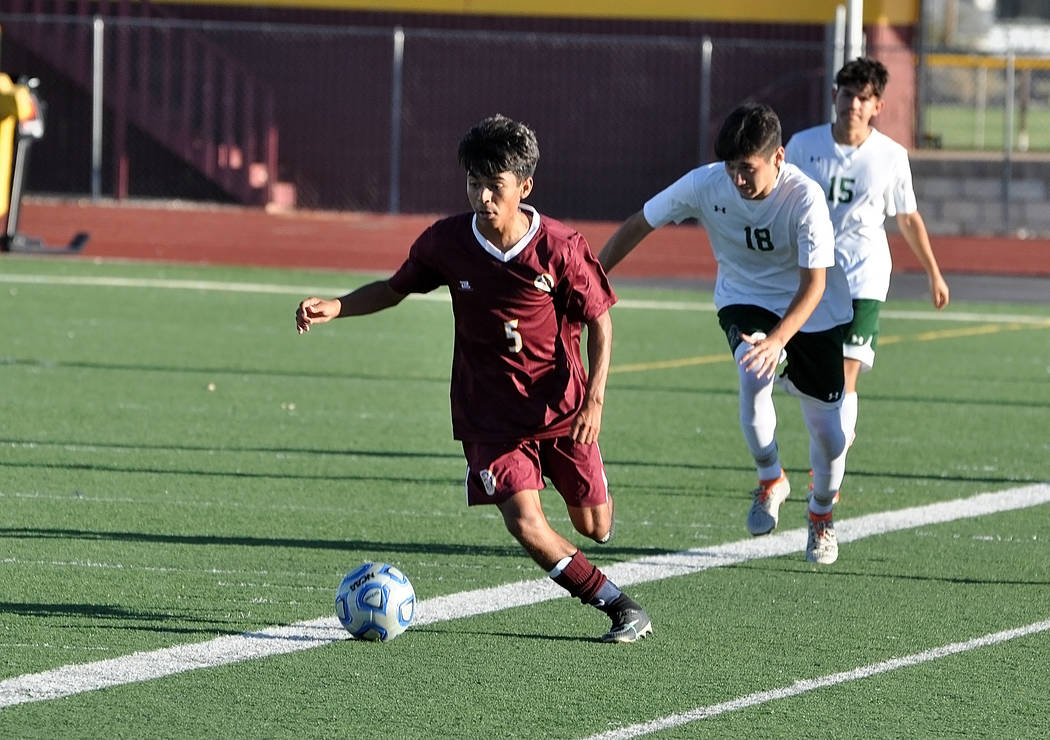 Horace Langford Jr./Pahrump Valley Times Christopher Vega finds room to maneuver against the Mojave defense during Pahrump Valley's 2-1 victory last Thursday, the Trojans' third consecutive win.