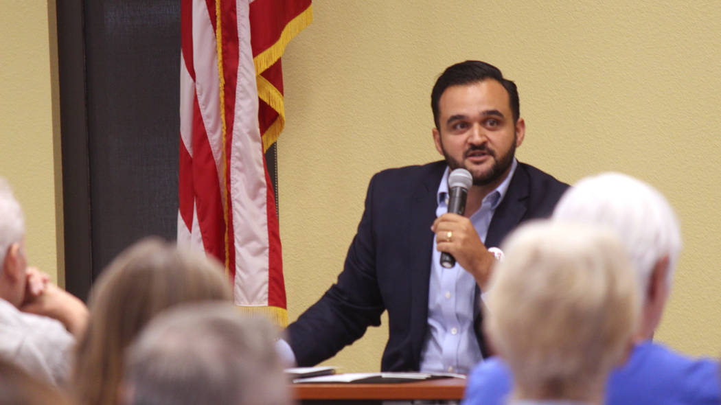 Jeffrey Meehan/Pahrump Valley Times Devlin Daneshforouz, outreach director for the Coalition to Defeat Question 3, speaks at Valley Electric Association's conference center at 800 E. Highway 372 o ...