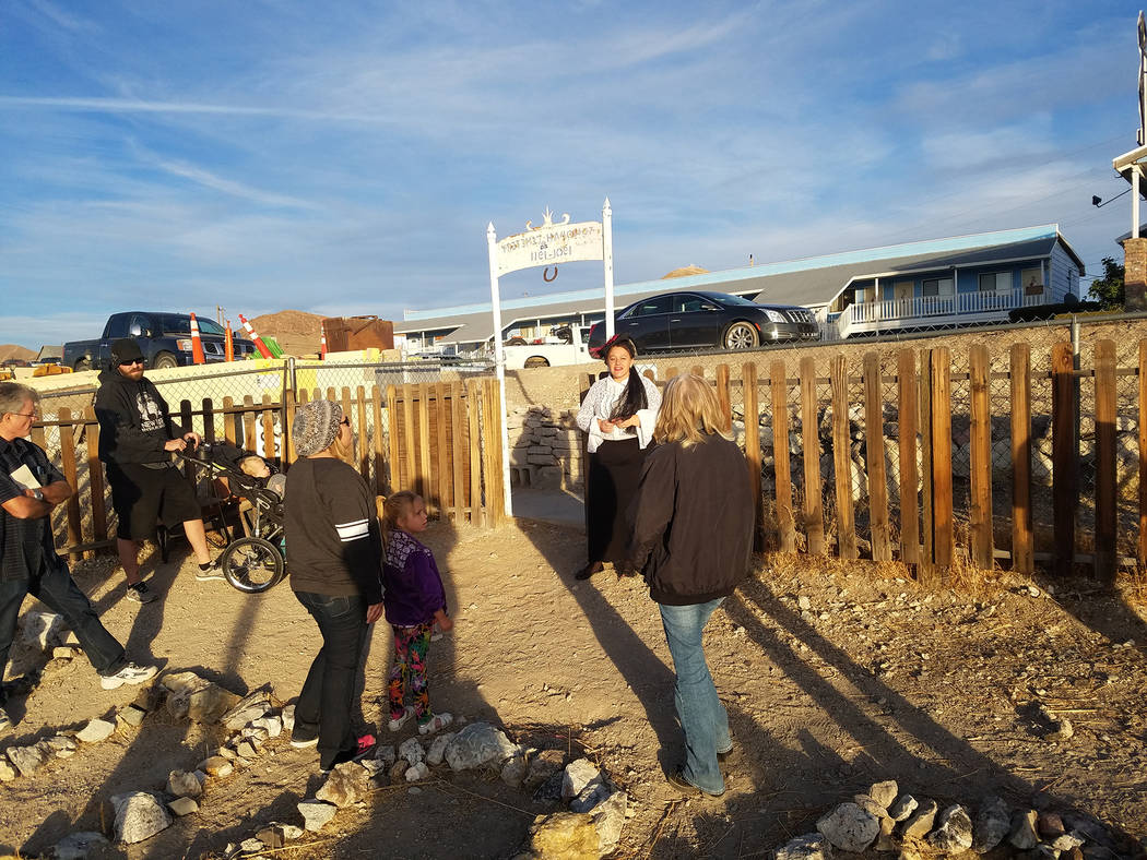 David Jacobs/Pahrump Valley Times Shari Bombard, dressed in special clothing depicting Tonopah's historic past, leads a group in the Tonopah Cemetery during the town's inaugural ghost walk on Oct. ...