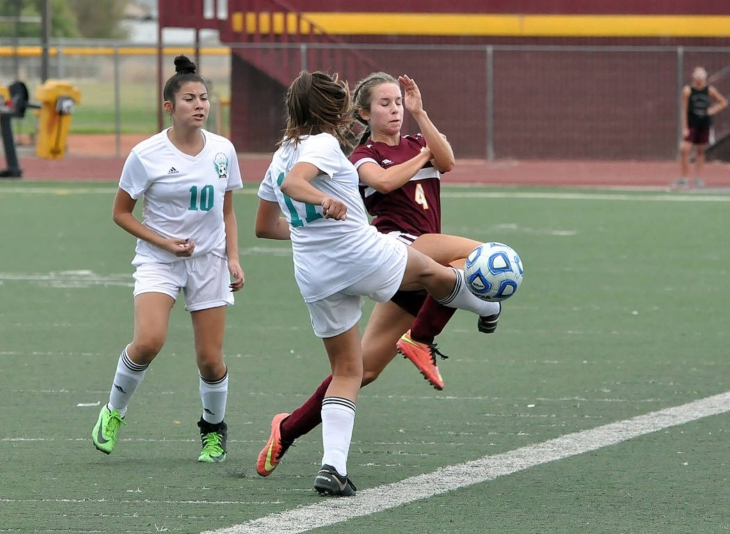 Horace Langford Jr./Pahrump Valley Times Senior Grace Gundacker battles for possession during Pahrump Valley's 6-1 win over Sky Pointe on Sept. 4 in Pahrump.