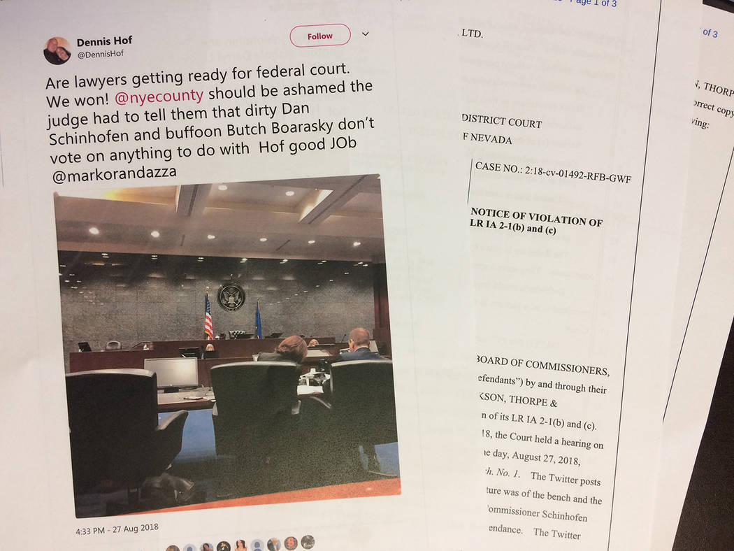 Robin Hebrock/Pahrump Valley Times A photo of the documents containing Nye County's of violation against Dennis Hof, with one of the Twitter photos in question shown.