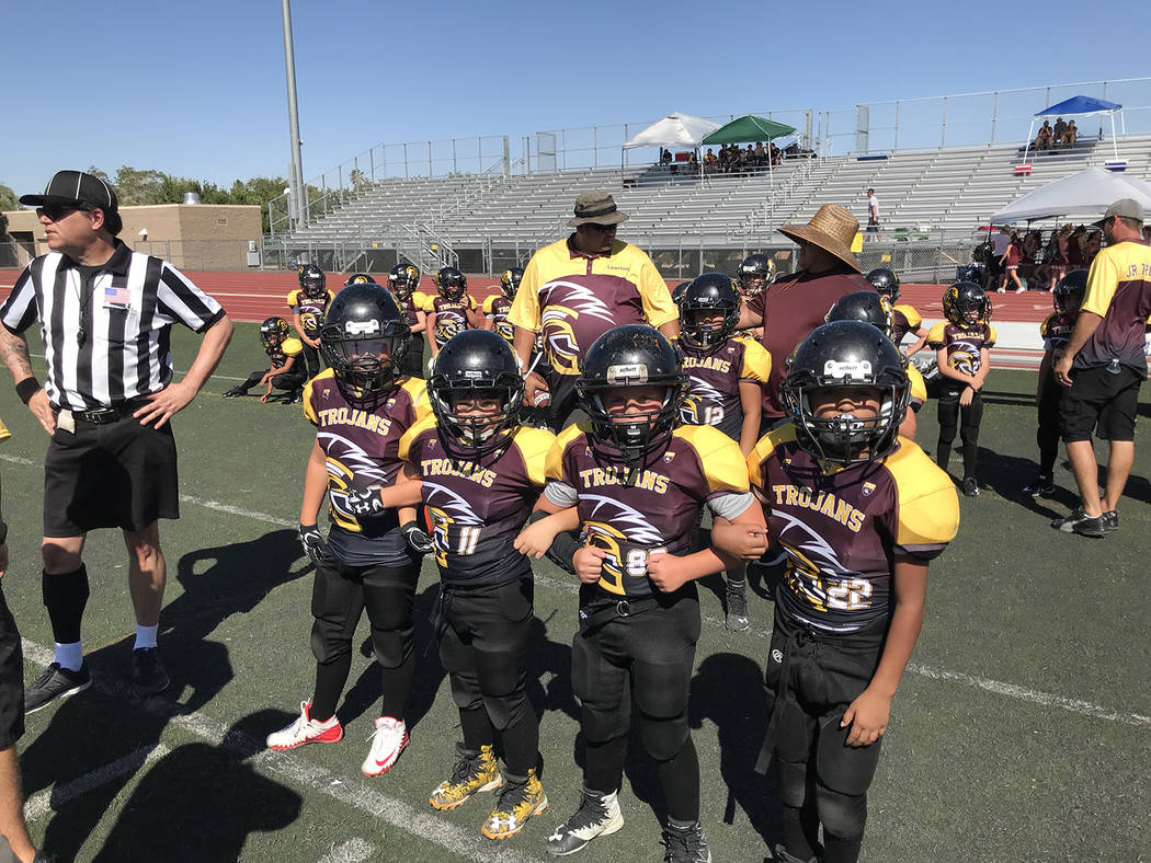 Johnny O'Neal/Special to the Pahrump Valley Times Pahrump Junior Trojans captains are ready for the coin toss before a National Youth Sports Nevada football game in Las Vegas.