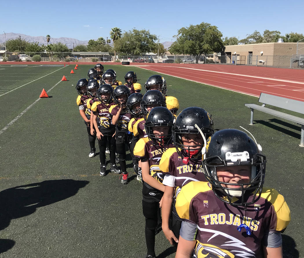 Johnny O'Neal/Special to the Pahrump Valley Times Lined up and ready to go, the Pahrump Junior Trojans prepare to take the field Sept. 8 at Rancho High School in Las Vegas.