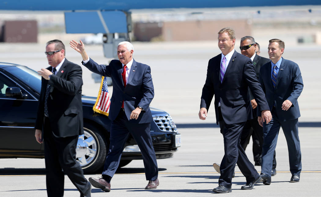 Vice President Mike Pence, from left, U.S. Sen. Dean Heller, and Attorney General Adam Laxalt exit Air Force Two after landing at Nellis Air Force Base in Las Vegas Friday, Sept. 7, 2018. K.M. Can ...