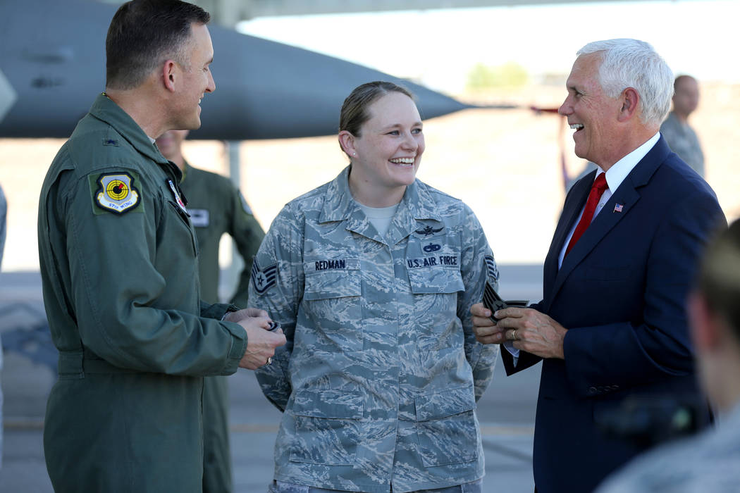 Vice President Mike Pence, right, and Brig. Gen. Rob Novotny, promote Staff Sgt. Vanessa Redman to technical sergeant at Nellis Air Force Base in Las Vegas Friday, Sept. 7, 2018. K.M. Cannon Las V ...