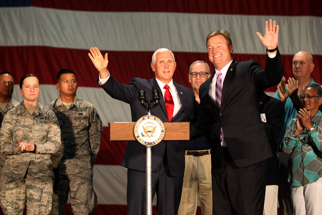 Vice President Mike Pence and U.S. Sen. Dean Heller acknowledge the crowd after speaking with airmen and veterans in the Thunderbirds hangar at Nellis Air Force Base in Las Vegas Friday, Sept. 7, ...