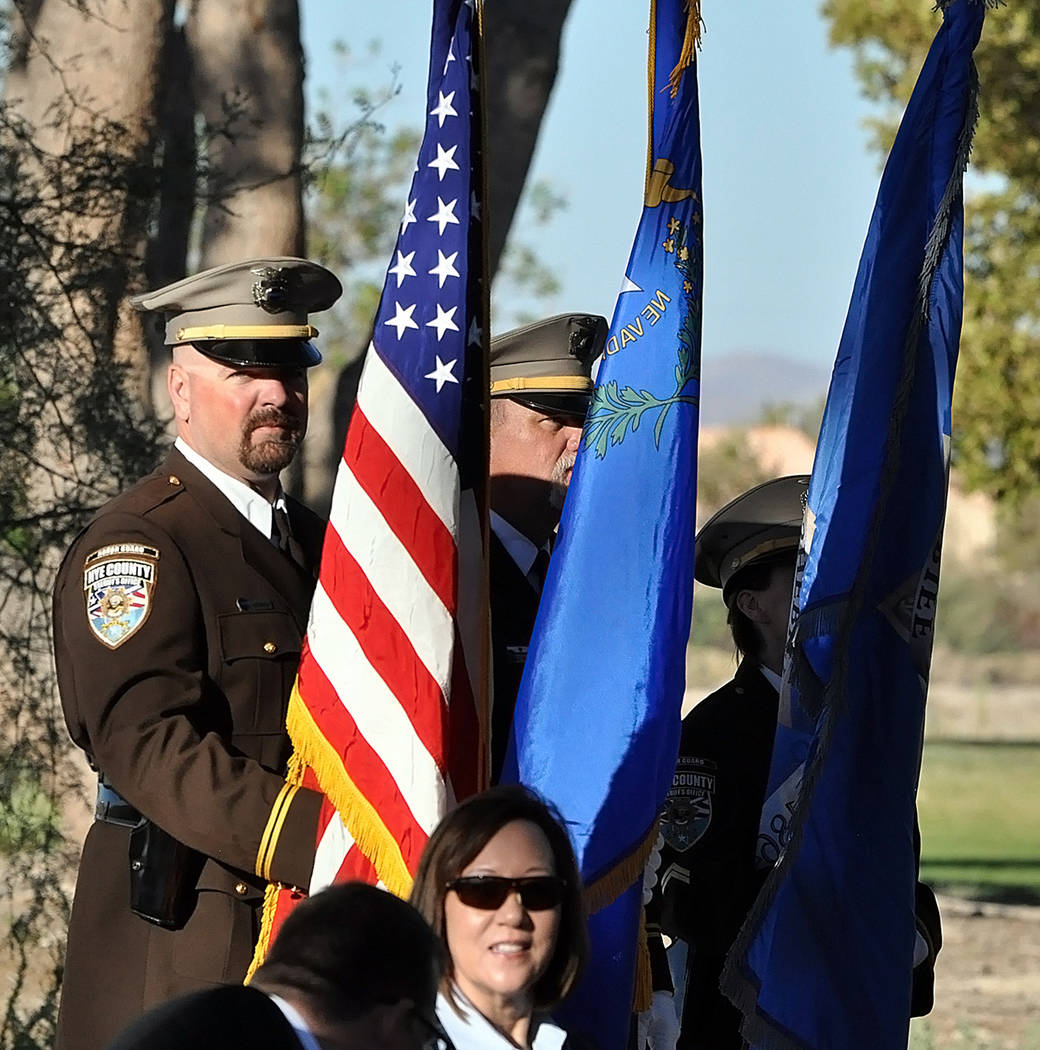 Horace Langford Jr./Pahrump Valley Times Members of the Nye County Sheriff's Office Color Guard posted the colors and stood at attention throughout the entire hour-plus ceremony. Members of the s ...