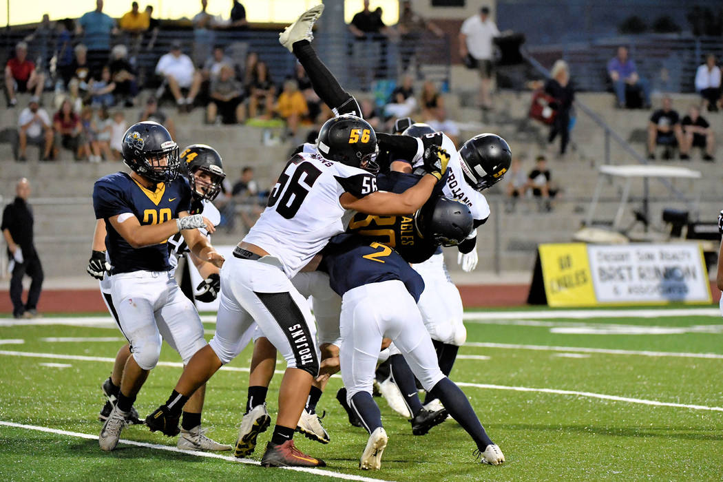 Peter Davis/Special to the Pahrump Valley Times Pahrump Valley's Casey Flennory gets lifted off the ground by the Boulder City defense during Friday night's 32-28 Eagles victory in Boulder City.