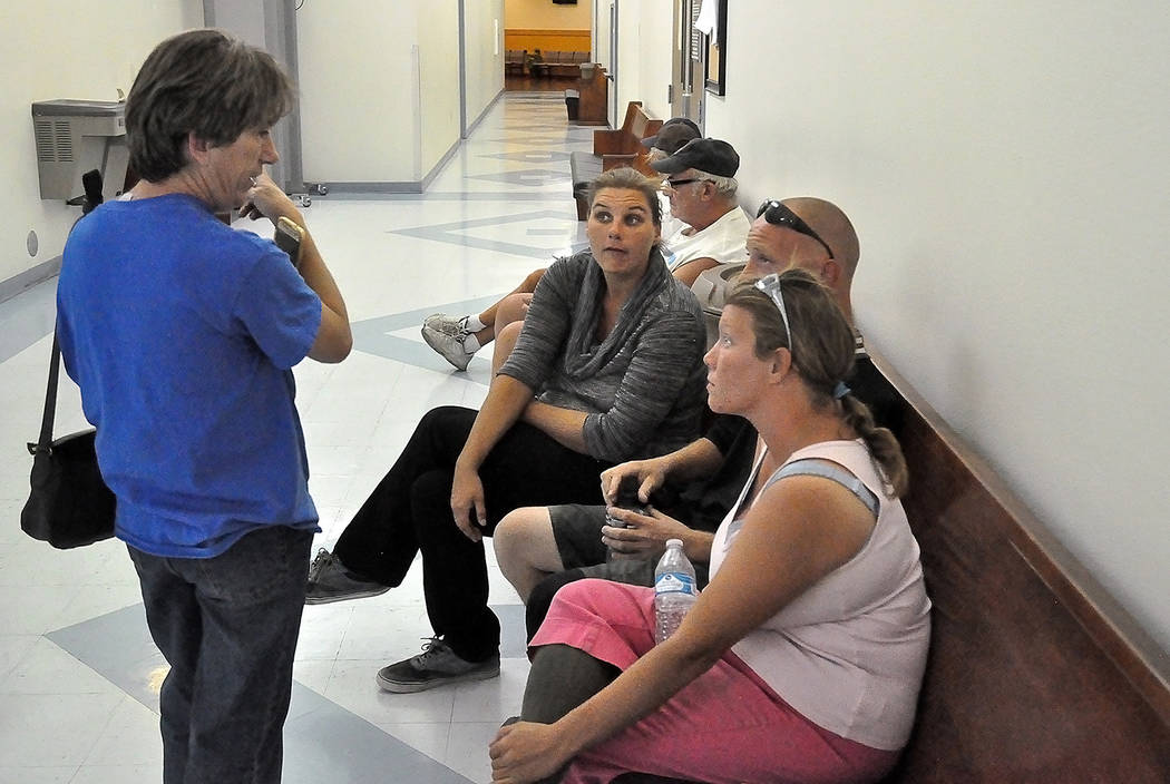 Horace Langford Jr./Pahrump Valley Times - Sept. 14, 2018, homeless residents Donna Vickerly, Ashley Hanson, Kyle Roberts and Tanya Dyche waiting to speak with an Attorney at the Pahrump Courthou ...