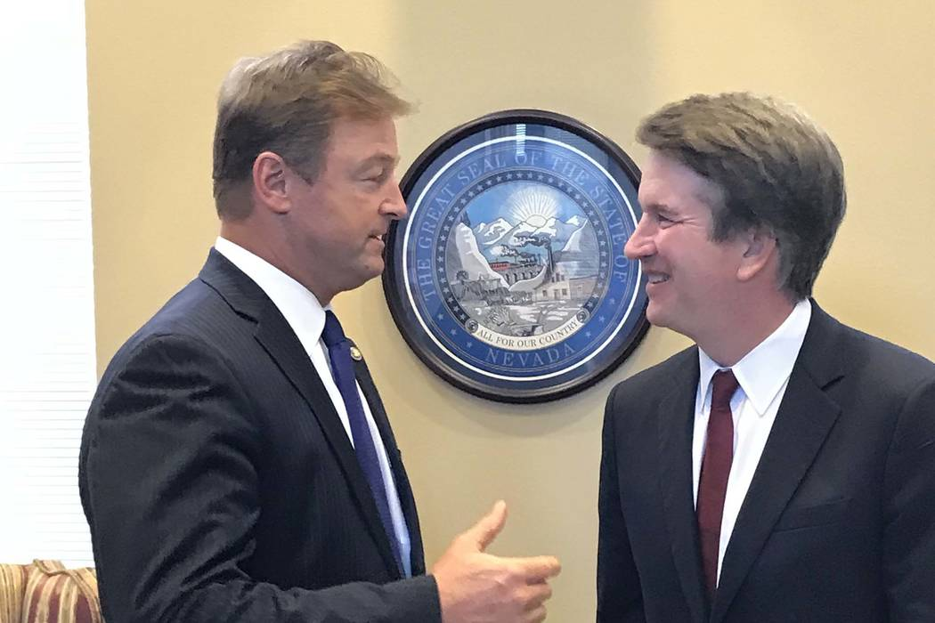 Sen. Dean Heller, R-Nev., left, meets with U.S. Supreme Court nominee Brett Kavanaugh at his office on Capitol Hill, Thur ...