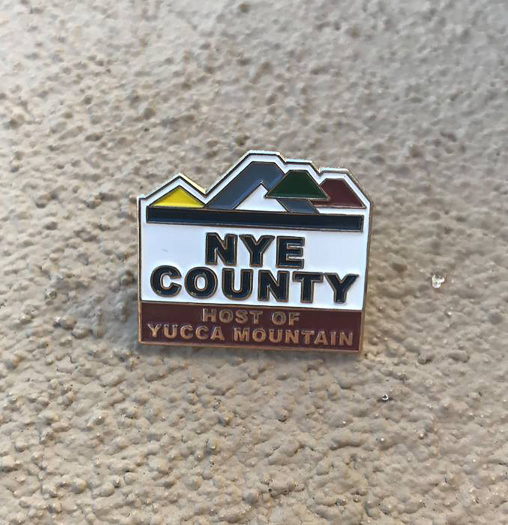 "Photo via Nye County Nye County Commissioner Dan Schinhofen gave House Speaker Ryan a Nye County lapel pin, similar to the one pictured, with the phrase ""Host of Yucca Mountain."""