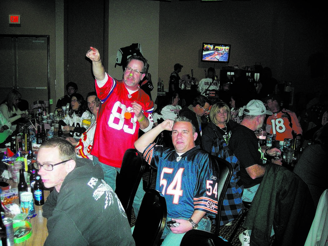 Mark Waite / Pahrump Valley Times - Denver Broncos fan Dave Pierce celebrates after his team's sole touchdown in the Super Bowl, at the Pahrump Nugget Casino party Sunday. The Seattle Seahawks t ...