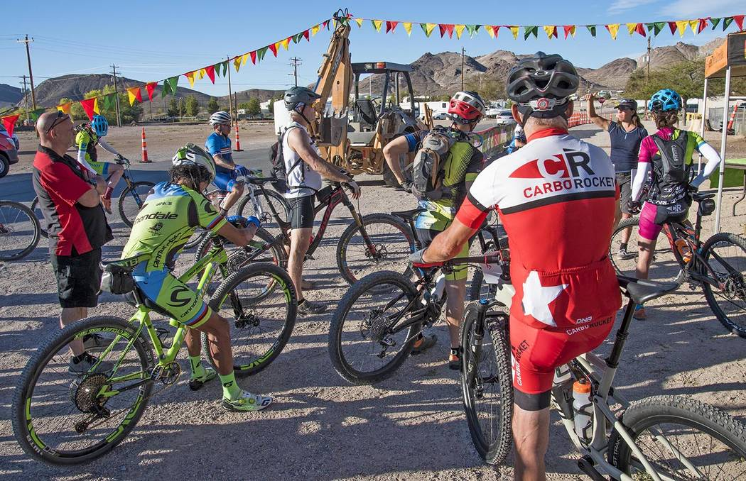 "Richard Stephens/Special to the Pahrump Valley Times David ""Tinker"" Juarez (on green bicycle) listens with other cyclists to pre-race instructions Saturday before the second Barrick Tinker Classic ..."