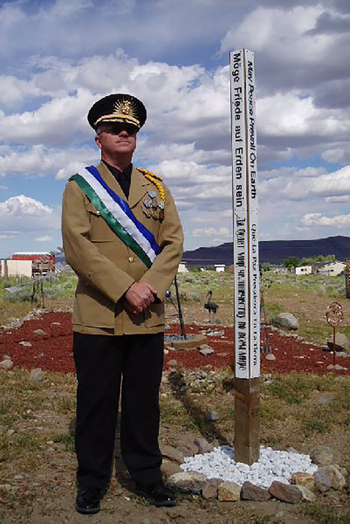 "Special to the Pahrump Valley Times Molossia's Peace Pole is a monument displaying the message and prayer ""May Peace Prevail on Earth,"" on each of its four sides, in eight different languages. The ..."