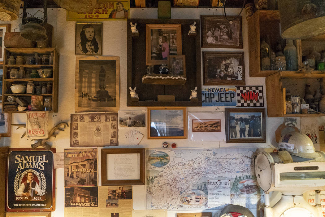 Photos, posters, maps and more old western memorabilia photographed in Walt Kremin's saloon at Gold Point, Tuesday, Sept. 4, 2018. After a decades long property dispute, the Bureau of Land Managem ...