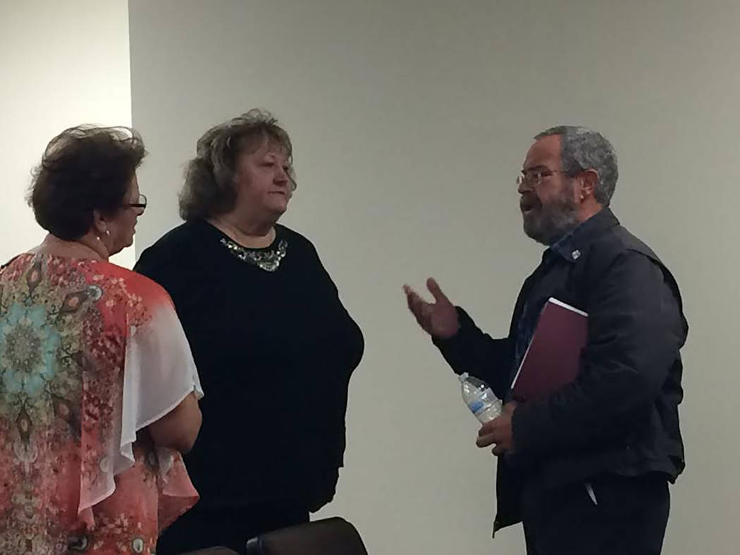 Robin Hebrock/Pahrump Valley Times Pam Webster, center, is pictured speaking with Nye County Commissioner Dan Schinhofen, right, and Nye County Assessor Sheree Stringer after her appointment to t ...
