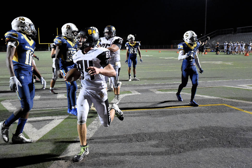 Peter Davis/Special to the Pahrump Valley Times Pahrump Valley sophomore Andrew Avena reaches the end zone for a 2-point conversion during the third quarter Friday night against Democracy Prep at ...