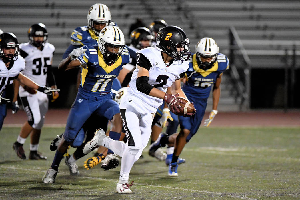 Peter Davis/Special to the Pahrump Valley Times Senior running back Joey Koenig finds room to run on the outside against Democracy Prep on Friday night during Pahrump Valley's 48-25 victory.