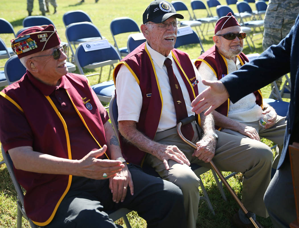 Military prisoners of war from left, Gene Ramos, Dean Whitaker, and Vincent Shank, attend a POW/MIA Recognition Day ceremony at Freedom Park inside Nellis Air Force Base in Las Vegas, Friday, Sept ...