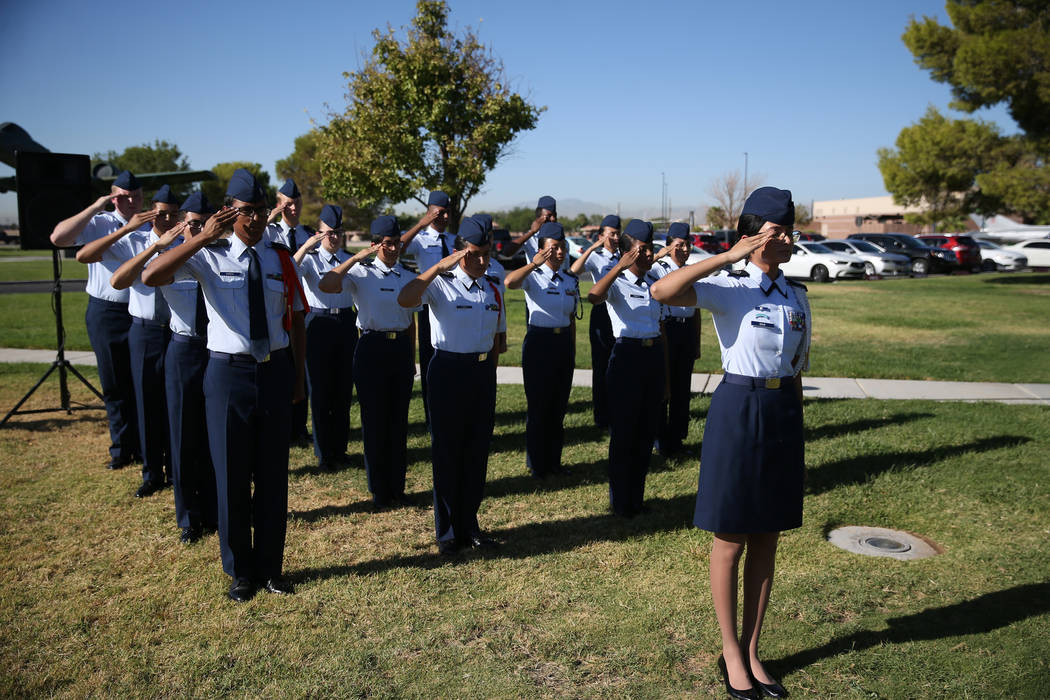 Rancho's JROTC Cadet Colonel Carlette Dias, far right, leads a salute during a POW/MIA Recognition Day ceremony at Freedom Park inside Nellis Air Force Base, in Las Vegas, Friday, Sept. 21, 2018. ...