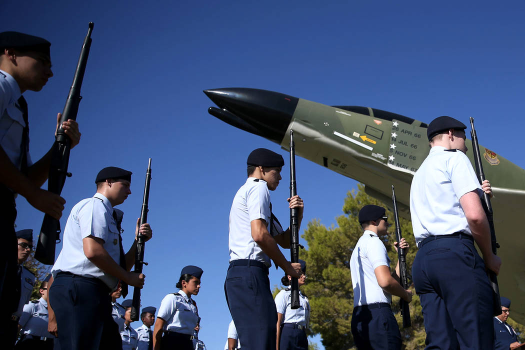 Rancho High School's JROTC armed drill team gets ready to perform a drill during a POW/MIA Recognition Day ceremony at Freedom Park inside Nellis Air Force Base in Las Vegas, Friday, Sept. 21, 201 ...