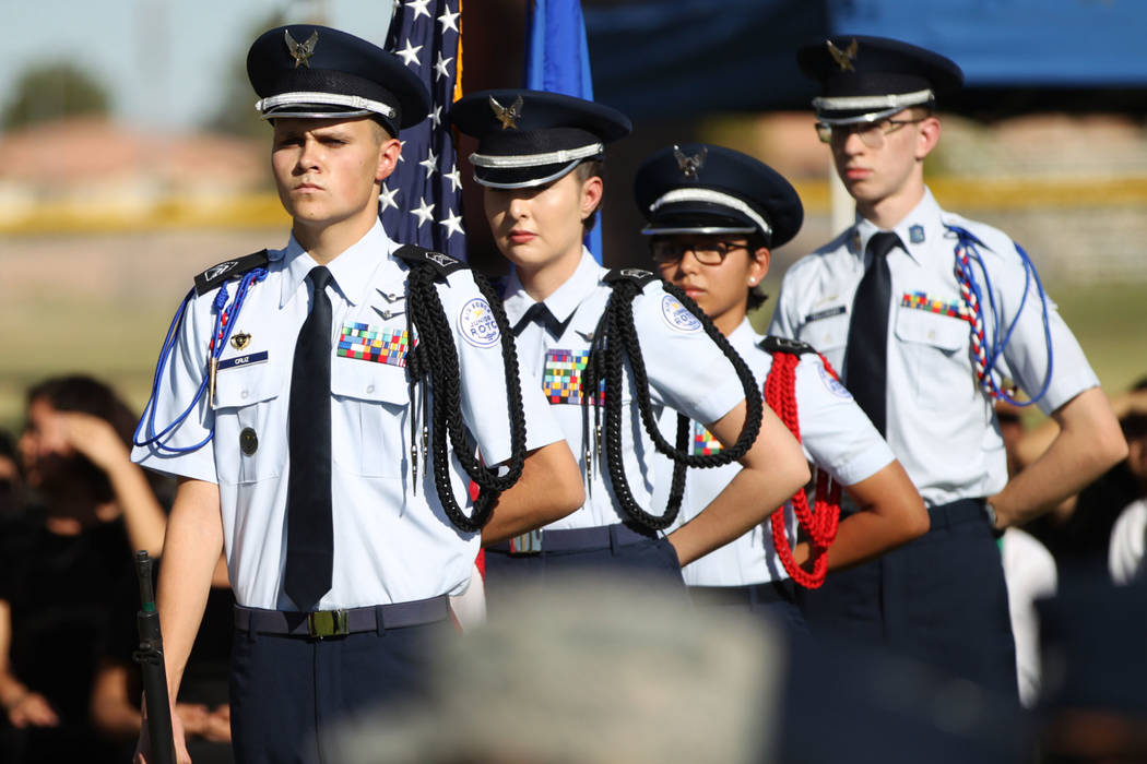 Rancho High School's JROTC color guard members from left, Damon Cruz, Stephanie Morales, Katelyn Dubro and Matthew Fellhauer, get ready to present the colors during a POW/MIA Recognition Day cerem ...
