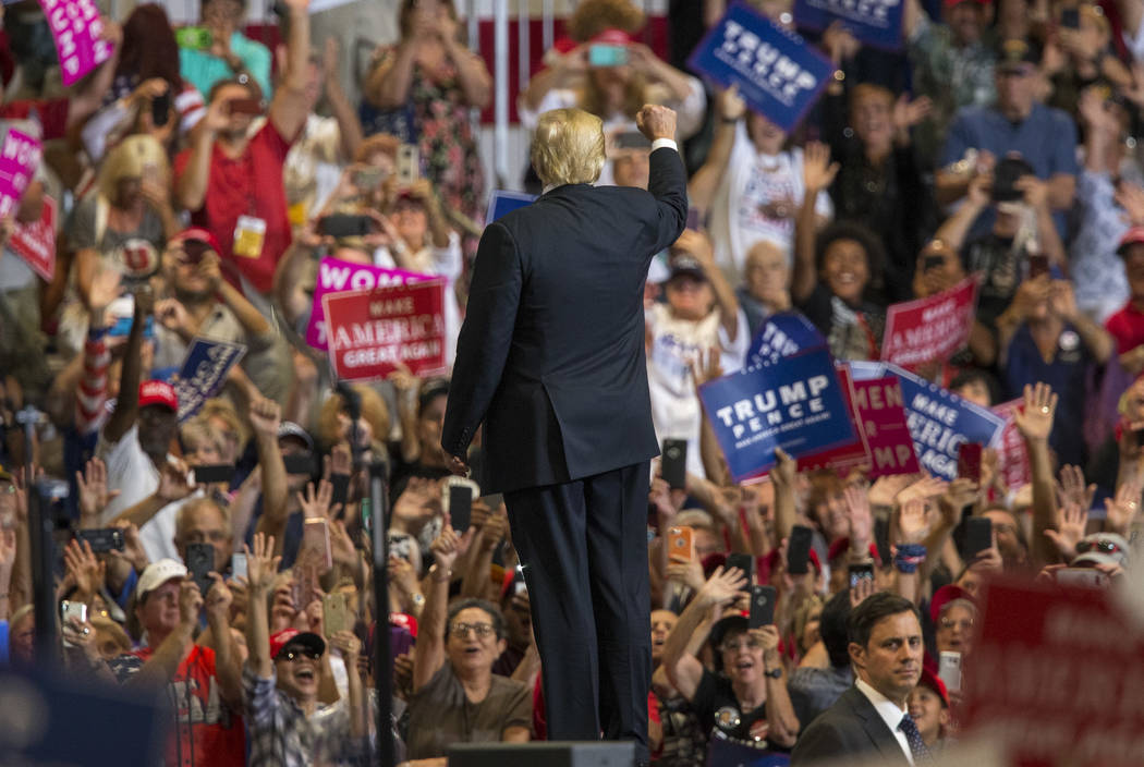 President Donald Trump waves to supporters after a Make America Great Again rally at the Las Vegas Convention Center in Las Vegas on Thursday, Sept. 20, 2018. (Richard Brian/Las Vegas Review-Journ ...