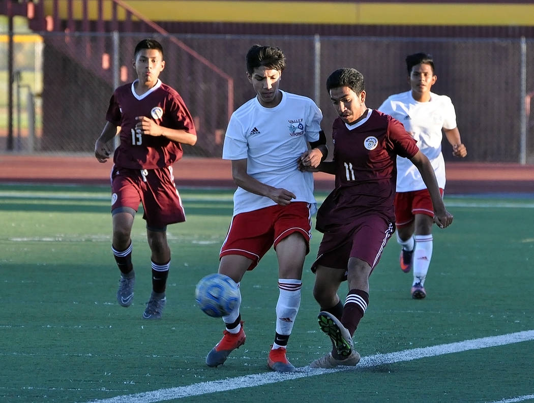 Horace Langford Jr./Pahrump Valley Times Senior Christian Gonzalez battles a Valley defender for possession during Pahrump Valley's 3-2 win Tuesday. Gonzalez recorded his seventh assist in the vic ...