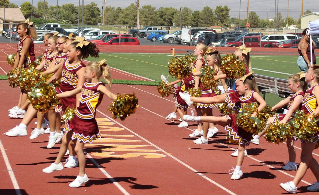 Tom Rysinski/Pahrump Valley Times The Junior Trojans Cheerleaders are an integral part of the scene at National Youth Sports Nevada football games.