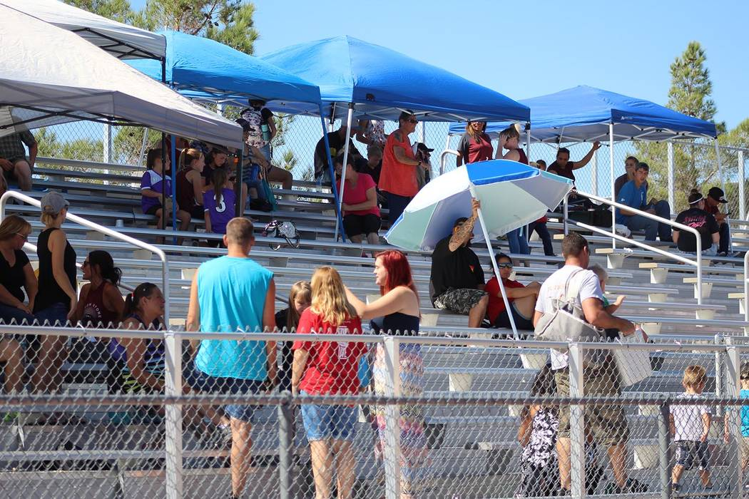 Tom Rysinski/Pahrump Valley Times With temperatures well into the 90s, prudent parents brought their own shade for the Junior Trojans and Junior Warriors games Saturday at Pahrump Valley High School.